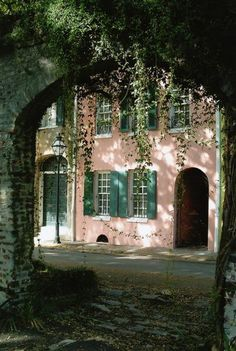 Pink house with green shutters; stone archway and vines. Pretty In Pink, Green Shutters, Green Windows, Ivy House, Pink Houses, Brick And Stone, Exterior Colors, House Colors, Old World