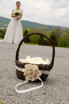 spraypaint a regular basket and add a pin with ribbon for a flowergirl basket.