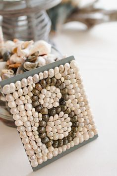 Glue miniature shells to pieces of slate to make your own table numbers.