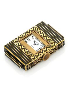CARTIER A FINE AND RARE 18K YELLOW GOLD AND ENAMEL SHUTTER WATCH CIRCA 1929 'ECLIPSE'