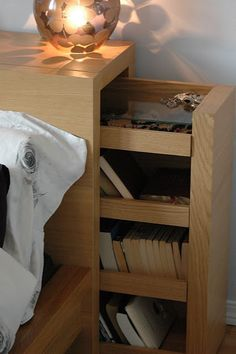 Bedside storage in headboard.  Put outlets in to hook up electronics and alarm clock