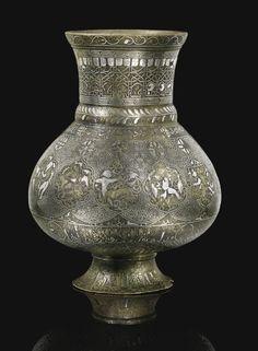 A SILVER-INLAID BRASS JUG, MESOPOTAMIA, MOSUL, FIRST HALF 13TH CENTURY
