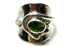 Spoon Ring set with a Peridot stone mixed with 9ct recycled Gold  www.khazimulajewellery.com/cutlery-jewellery/