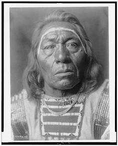 Leads the Wolf  1 photographic print. | Head-and-shoulders portrait of Crow man.  Contributor:Curtis, Edward S. Original Format:Photos, Prints, Drawings Date:1908