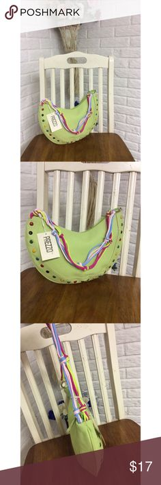 """Prezzo Multicolor Studded Handbag This unique handbag by Prezzo, is made of lime green canvas material, and features colorful studded detailing.   *Made of canvas material *Zip closure *Multicolor knotted rope handle *Striped interior, with one zip pocket  The handbag measures:   Length: 12.5"""" Height: 7.5"""" Width: 0.5"""" Strap Drop: 11""""  New; with original tag attached Prezzo Bags"""