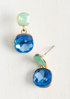 It may not come as a shock that the mint green and sapphire blue faux stones of these dangly earrings make a gorgeous combination, but the sparkle factor their faceted faces and gold frames offer will definitely give your overall look an element of surprise!