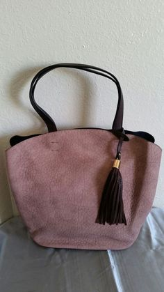 New (never used) - Champagne color soft suede 2 in 1 handbag. Detachable divider that you can carry as a crossbody,  comes wirh shoulder strap. Brand new. Serious inquiries and cash only. Thanks