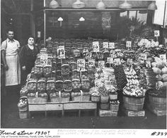 A fresh produce display in front of a Danforth grocery store, Toronto, Canada, c. 1930s. #vintage #supermarket #shopping
