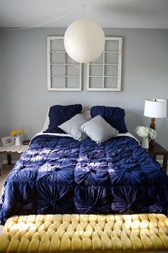pretty bedding, but it needs more pillows. Also, like the wall color