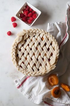 Apricot Raspberry Pie + Real Talk: Migraines — Style Sweet Apricot Raspberry Pie with an all butter crust in a braided, lattice, & leaf design. Köstliche Desserts, Delicious Desserts, Dessert Recipes, Plated Desserts, Lattice Pie Crust, Pie Crust Designs, Pie Crust Recipes, Pie Crusts, Pie Decoration