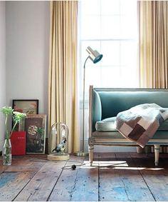 blue velvet couch. wood floor, rustic simple interior