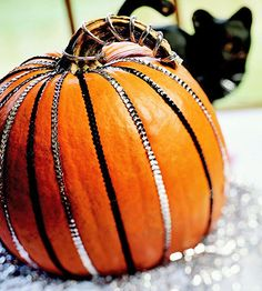 As elegant as a dancer's dress, this pumpkin dons stripes of sequins in silver and black.