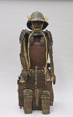 Suit of antique Japanese lacquered iron samurai armor, including: helmet (kabuto) (no crest/plume); half mask (mempo), with detachable nose and 5-lame throat guard; cuirass (do) pending hanging tassets (kusazuri); pair shoulder guards (sode); pair armored sleeves (kote) with hand guards (tekko); pair thigh guards (haidate); and pair shin guards (suneate); with patterned fabric backing and lacing (flaws, worn, some losses); Edo Period or earlier;