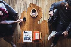 American Cherry hardwood coffee table shaped like the Mitten state. Rhino Media.