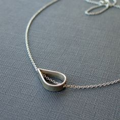 SHIPPING AFTER 12/25 Set Adrift Necklace Sterling Silver Open Teardrop Sliding Element Simple Jewelry Modern Design Handmade by ShopClementine on Etsy https://www.etsy.com/listing/60457558/shipping-after-1225-set-adrift-necklace