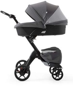 Stokke Athleisure Xplory® Carry Cot with Shell, Gray/Black $224 -Stokke Carry Cot, designed for use with the Xplory stroller (sold separately). Includes lining, mattress, wind/rain cover, and seat with textiles. Height adjustable: brings the baby closer to mom and dad. Curved base with air ventilation. Integrated pockets for storage. Optional opening for ventilation through 30% of the hood to prevent your child overheating. Opening protected by mosquito net.  #ad #baby