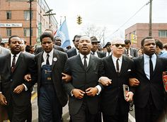 John Lewis (far right) with Dr. Martin Luther King, Jr. (center) leading a civil rights march in Alabama from Selma to Montgomery to protest restrictive voting rights for African Americans in 1965.