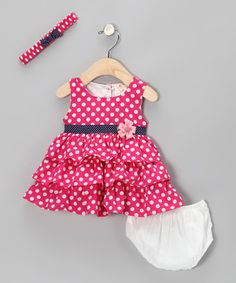 Featuring step-by-step delight, this combo twirls a trail of joy everywhere it goes. The dress includes a tiered ruffle skirt, buttons in back and a flower embellishment across the bodice, while the matching headband and diaper cover keep sweeties adorable from top to bottom.