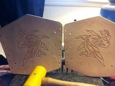 Tooled dragon bracers