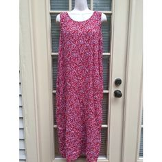 ⬇️ *Sale!* Gorgeous vintage red floral maxidress - Gorgeous vintage red maxi dress with blue and white floral designs  - Perfect maxi for the spring! - Sleeveless, zipper in the back, slit in the back of the dress as well - In good condition, only a few small strings hanging near the slit (see photo)  - Very flowy and roomy, perfect to throw on and feel comfortable in  - Length: 4'1 feet, slit starts at 1'7 feet (a little high up)  - Brand: Vintage - Size: tag says 16XL but fits like a 10M…