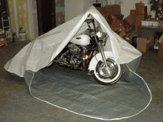Motorcycle storage pocket by Rhino will keep your motorcycle dry and clean while it's tucked away in your garage. www.ecanopy.com $88.99