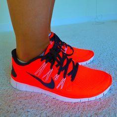 Nike neon orange minimalist running shoes sneakers