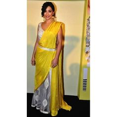 A beautiful yellow saree Amrita Puri wore in a function. Free shipping offer.