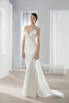 Wedding gown by Ultra Sophisticates by Demetrios