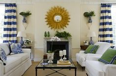Bright crisp blue, cream, kelly green, and blasts of gold in...