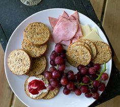 Easy lunch box ideas: cream cheese and jam sandwiches on whole-grain crackers; crackers with ham and cheese; and grapes. http://www.LunchBox...