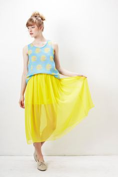The floaty chiffon Sunspot Skirt will keep you looking cheerful and bright all summer long.    features  gathered elastic waistband  floaty silk chiffon outer  shorter underlining    material  100% silk outer  100% rayon lining