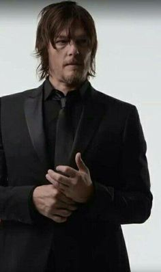 "Jeans and a vest ""a'la Daryl"" Sweats black tie ...he can wear it all and still look good"