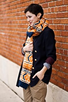 pixie cut for thick hair, layered sweeter, chunky scarf and khaki pants... I love this look.