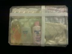 Baby gift made easy. Empty candy case, 3 receiving blankets, 3 wash cloths, 3 miniature bottles baby wash, lotion & shampoo, tape & ribbon!
