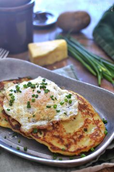Cheesy Irish Potato Pancakes - potatoes, cheddar, chives, flour, milk, garlic, salt, pepper.  Serve with fried eggs.