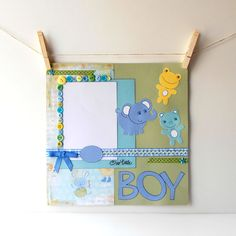12x12 Premade Scrapbook Page Baby Boy Theme with Elephant Bear and Frog in Blue and Green. $18.00, via Etsy.
