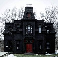 Gorgeous black gothic victorian house home red door
