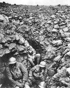 """The hell that was Verdun: Infantrymen of the French 87th regiment """"rest"""" in trench at Hill 34 outside Verdun. The incessant bombardment by both sides changed the battlefield's physical topography."""