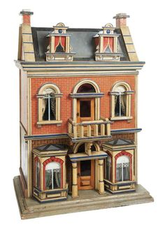 German Blue-Roof Dollhouse by Moritz Gottschalk (leads to a nice yahoo image search for German Dollhouse)