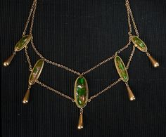 1900s Art Nouveau Swag Necklace, Green Glass, 10K, and Gold Filled Components from eerie basin