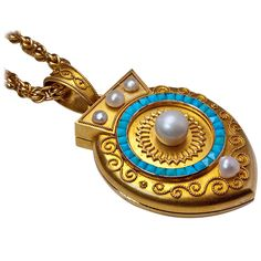 Archaeological Revival Gold Pearl Turquoise Locket Pendant c 1885 | From a unique collection of vintage drop necklaces at http://www.1stdibs.com/jewelry/necklaces/drop-necklaces/