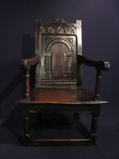 """A FINE EARLY 17TH CENTURY WEST COUNTRY OAK WAINSCOT ARMCHAIR. CIRCA 1630. THE SHAPED TOP RAIL WITH LUNETTE CARVING ABOVE AN ARCHADED CARVED PANELLED BACK WITH LEAF, BERRY AND INTERLOCKING """"S"""" SCROLL DECORATION. WITH A TYPICAL WEST COUNTRY TAPERED SEAT. STANDING ON TURNED LEGS UNITED BY STRETCHERS. FINE COLOUR AND PATINATION. POSSIBLY SALISBURY. 41"""" HIGH X 27"""" WIDE X 21"""" DEEP."""
