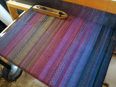 Gorgeous Gorgeous yardage being woven by Daryl Lancaster.  I LOVE her use of long warp floats... and of color.  Check her out at weaversew.com