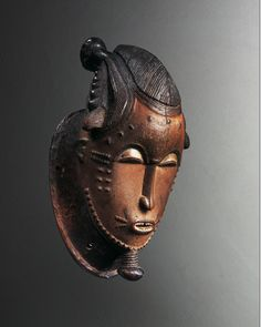 """Mask from the Goli group l """" Kpwan"""" l Côte d'Ivoire l Baule l 1st half of the 20th century l Hardwood, remains of polychromy l H.: 45.3 cm l Formerly Hubert Goldet collection."""