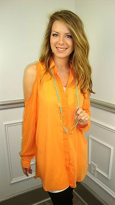 This top feels like buttah!! It's creamy fabric and bright melon hue are just two of the reasons we love this piece… the long length, bust pocket and cutout shoulder make it perfectly on trend for spring 2012! Wear with skinny jeans, leggings or white denim… OR, layer it with a slip and make it a dress! #shopbluedoor
