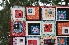 Like the use of white in this squares-in-squares quilt