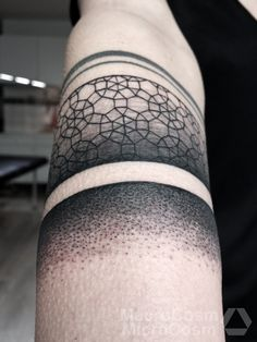 Abstract, black and white, dotwork, geometric, forearm tattoo on TattooChief.com