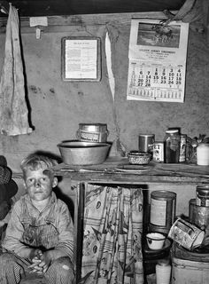 "February 1939. ""Child of migrant sitting by kitchen cabinet in tent home near Edinburg, Texas."" Ten Commandments, meet Jersey Creamery. Medium-format negative by Russell Lee for the Resettlement Administration. View full size."