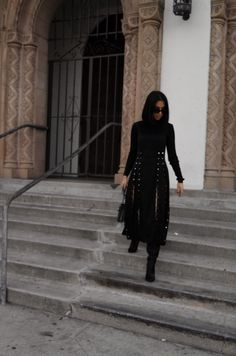 LA Blogger Tania Sarin in LA wearing Maria Piankov double slit skirt and knee high boots.