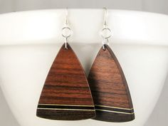 Handmade from natural wood free of dyes or stains. Wenge earrings with zebrawood, maple & ebony on sterling wires. One of a kind wearable art. Beeswax Polish, Triangle Earrings, Wood Earrings, Polymer Clay Jewelry, Dyes, Metal Jewelry, Wearable Art, Natural Wood, Woodworking Projects